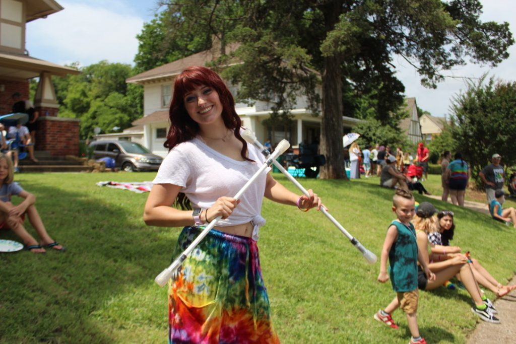 Jenni Jenkins at Oklahoma City Pride Parade with Double staffs
